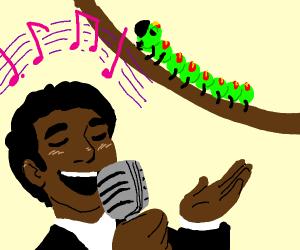 Guy sings to caterpillar.