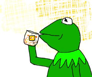 kermit is drinking some lipton tea