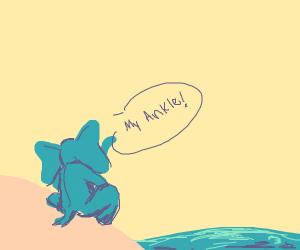 An elephant with a sprained ankle on a beach