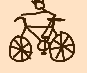 A boy riding a bycicle