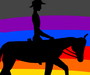 cowboy riding at sunset