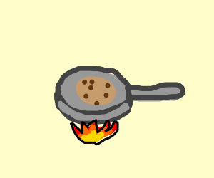 Chocolate Chip Pancakes in Pan Over Fire
