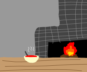 Bowl of soup next to fireplace