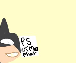 Batman reads a note