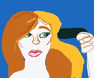 Girl blow dries her hair with a handgun.