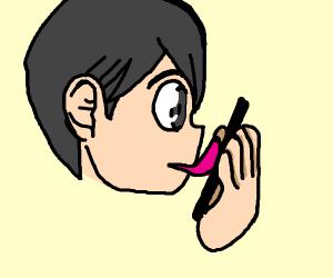man licking a phone