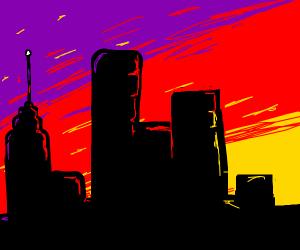 sunset behind a city