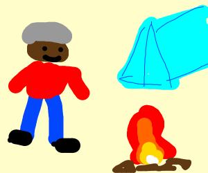 A man near a blue tent & campfire