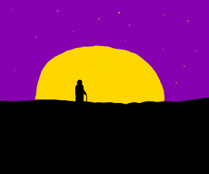 Sillhouette of person watching sunset
