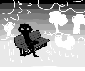 man on bench in the countryside