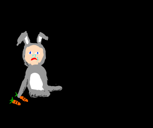 baby in rabbit suit eating carrots sadly