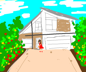A modern house with flowers and a lady.