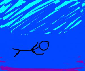 black diver swims in empty sea