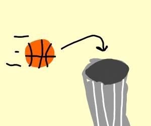 Making a basketball shot at the trash can
