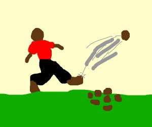 black dude kicking rocks