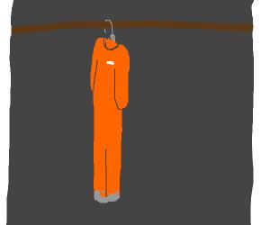Orange jumpsuit on a hanger