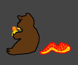 An octopus tentacle behind a bear