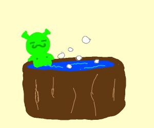 Shrek chillin in a hot tub