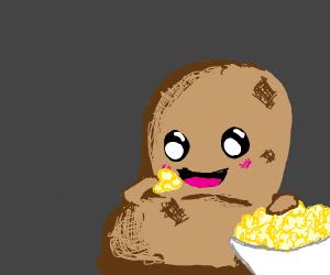 A potato snacks on some popcorn