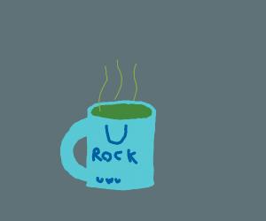 Blue Mug that has Green Tea Inside