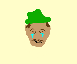 Sad man in green hat