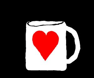 A coffe mug with a heart on it