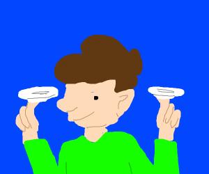 guy balancing plates on his body