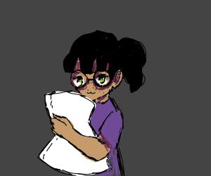 Nerd holds a pillow