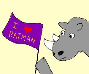 """The Rhino holds a flag saying """"I love batman"""""""