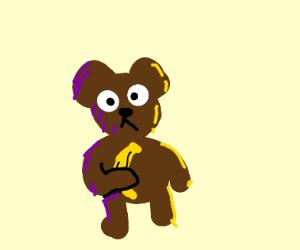 Brown bear cub holding banana