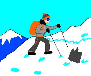 Man walks up snowy mountain