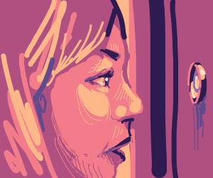 woman looks through peephole
