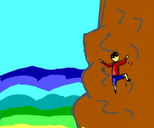 a guy climbing the mountain top
