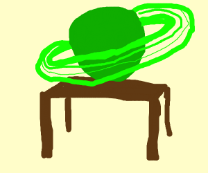 A green Saturn on a table