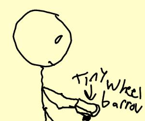 guy holding mini wheelbarrel