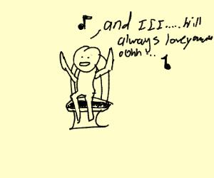 Man singin on the toilet