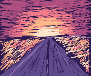 a road heading towards the sunset