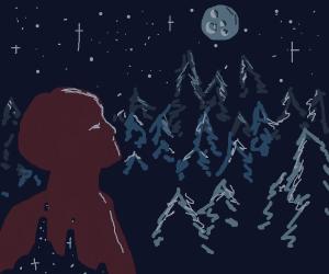 man looking at the moon