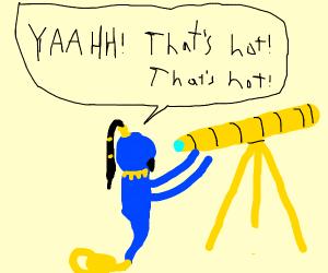 Genie looks through telescope @ something hot