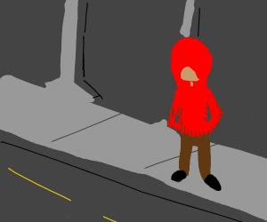 Red hooded guy walkin thru a city street
