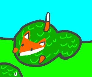 Fox hiding in bushes