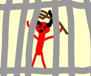 Devil behind bars