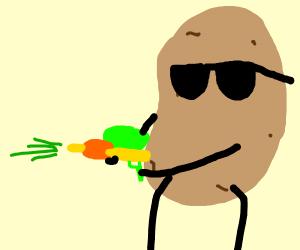 Potatoe with squirt gun shooting green liquid
