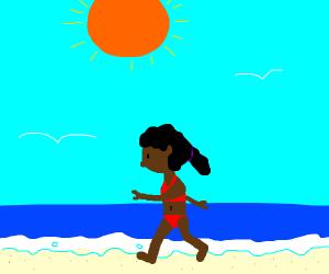 A girl walking on the beach