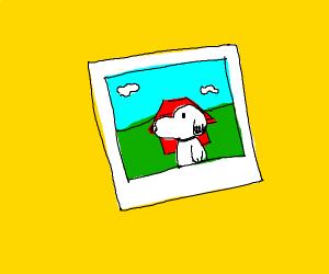 a polaroid photo of snoopy