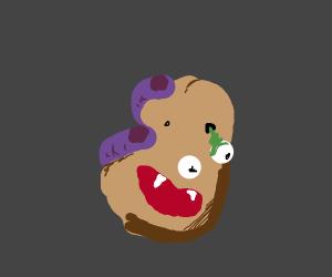 Giant fingers holding a mutated Mr Potatohead