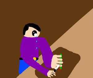 Man cuts himself and cries