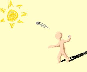 Man throwing at something