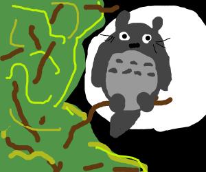 Totoro sitting in a tree