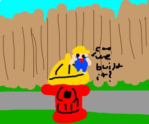 Tiny Bob the Builder on fire hydrant